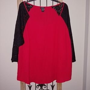 Red top with black lace sleeves